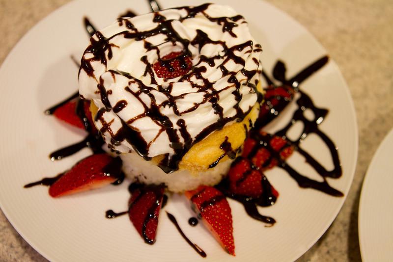 Tasty desert with angel food cake, strawberries.
