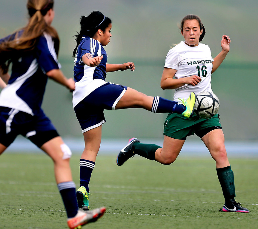 . Harbor High\'s Xenia Marquez is nearly kicked by The King\'s Academy senior Victoria Ramirez as she attempts to block a pass during the CCS Division III girls soccer finals on Saturday at Valley Christian High in San Jose. (Kevin Johnson/Sentinel)