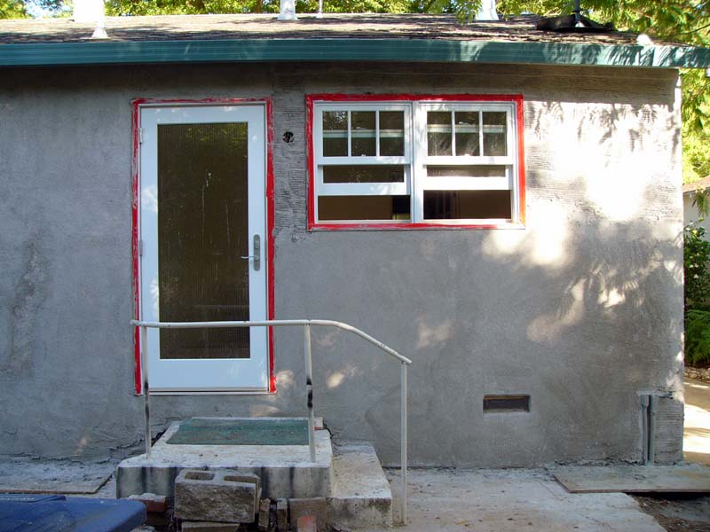 June 18 - Exterior is being patched and stuccoed.  This needs another coat.  Then a good long dry until painting.  The patio is next....