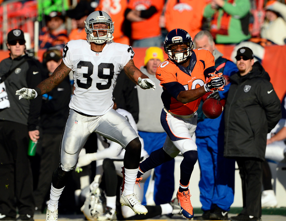 . DENVER, CO - DECEMBER 28: Emmanuel Sanders (10) of the Denver Broncos doesn\'t complete a catch and is flagged for a face mask during the first quarter.  The Denver Broncos played the Oakland Raiders at Sports Authority Field at Mile High in Denver on December, 28 2014. (Photo by Joe Amon/The Denver Post)