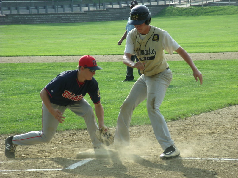AMERICAN LEGION 17U TOURNEY - a Willimantic runner beats the tag on a pickoff attempt by Winsted's Ryley Weiss.JPG