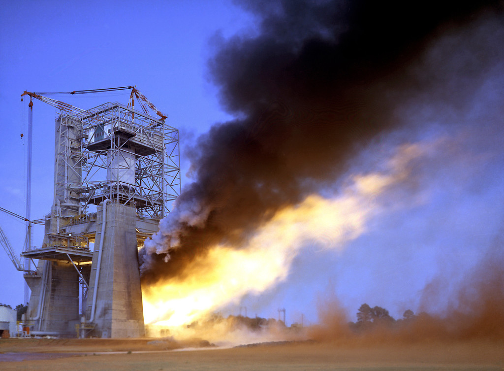 . Test firing of all five F-1 engines for the Saturn V S-IC test stage at the Marshall Space Flight Center. (NASA/MSFC)