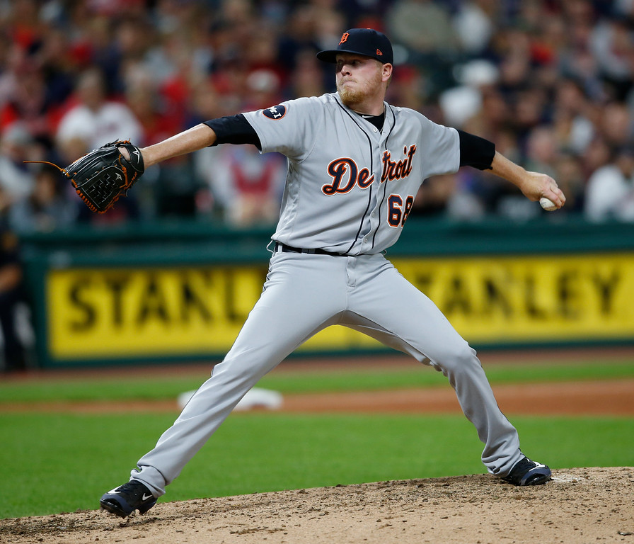 . Detroit Tigers relief pitcher Daniel Stumpf delivers against the Detroit Tigers during the eighth inning in a baseball game, Tuesday, Sept. 12, 2017, in Cleveland. (AP Photo/Ron Schwane)