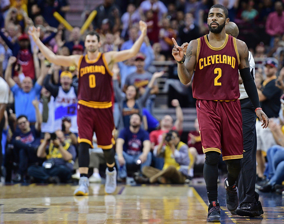 . Cleveland Cavaliers guard Kyrie Irving (2) celebrates after a 3-point basket in the second half of an NBA basketball game against the Houston Rockets, Tuesday, Nov. 1, 2016, in Cleveland. The Cavaliers won 128-120. (AP Photo/David Dermer)