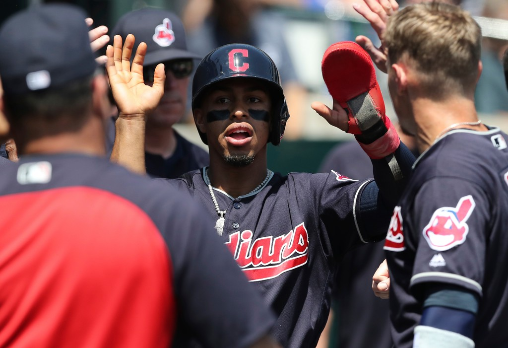 . Cleveland Indians\' Francisco Lindor is greeted in the dugout after scoring during the fourth inning of a baseball game against the Detroit Tigers, Wednesday, May 16, 2018, in Detroit. (AP Photo/Carlos Osorio)