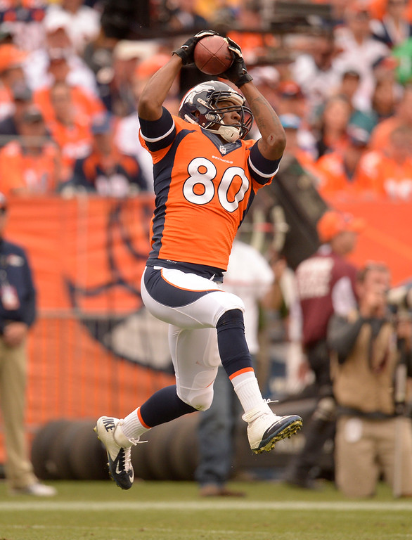 . Denver Broncos tight end Julius Thomas (80) catches a pass Peyton Manning during the third quarter against the Philadelphia Eagles September 29, 2013 at Sports Authority Field at Mile High in Denver . (Photo by John Leyba/The Denver Post)