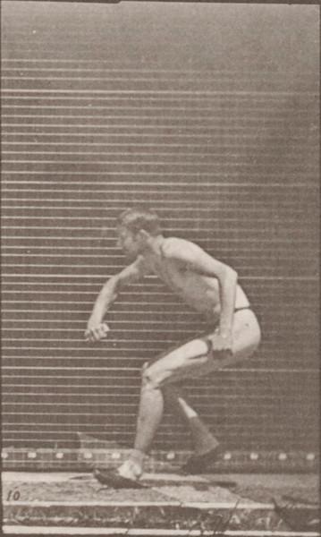 Man in pelvis cloth running and jumping horizontal bar