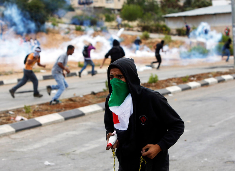. A Palestinian protestor takes part in clashes with Israeli security forces to mark Nakba Day near the West Bank city of Ramallah May 15, 2013. Palestinians clashed with Israeli forces in the occupied West Bank and at East Jerusalem on Wednesday during demonstrations to mark 65 years since what they call the Nakba (Catastrophe) when Israel\'s creation caused many to lose their homes and become refugees. REUTERS/ Mohamad Torokman