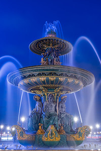 Fountain at Place de la Concord in Paris France by dusk