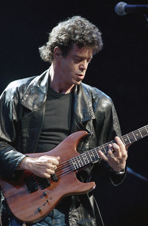 . FILE - In a June 13, 1986 file photo, Lou Reed performs during musical number at a benefit in Chicago, for Amnesty International. Reed\'s literary agent Andrew Wylie says the legendary musician died Sunday morning, Oct. 27, 2013 in Southampton, N.Y., of an ailment related to his recent liver transplant. He was 71. (AP Photo/Fred Jewell, File)