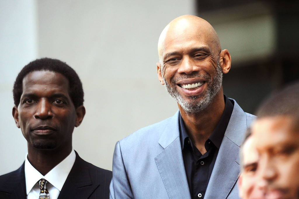 . Kareem Abdul-Jabbar lets out a smile as he is introduced during a press conference at Los Angeles city hall regarding NBA Commissioner Adam Silver\'s banning of Donald Sterling for life from any association with the Clippers or the NBA  April 29, 2014.(Andy Holzman/Los Angeles Daily News)