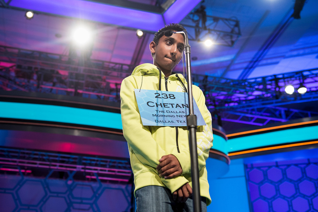 """. Chetan G. Reddy, representing Texas, reacts after misspelling a word during the championship round at the Scripps National Spelling Bee May 30, 2013 in National Harbor, Maryland. Arvind V. Mahankali, representing New York, won by correctly spelling \""""knaidel\"""", a German-derived Yiddish word, defeating Pranav Sivakumar, representing Illinois. BRENDAN SMIALOWSKI/AFP/Getty Images"""