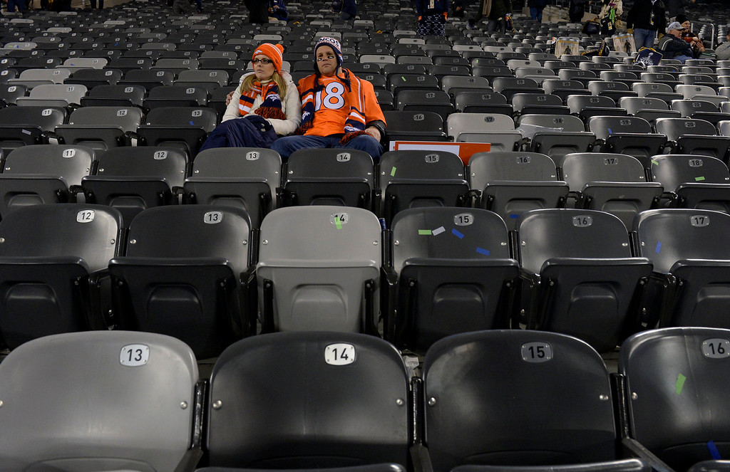 . James Martin III and his wife Sara Martin of Colorado Springs sit in their seats after the Broncos were defeated by the Seahawks 43 to 8.  The Denver Broncos vs the Seattle Seahawks in Super Bowl XLVIII at MetLife Stadium in East Rutherford, New Jersey Sunday, February 2, 2014. (Photo by Craig F. Walker/The Denver Post)
