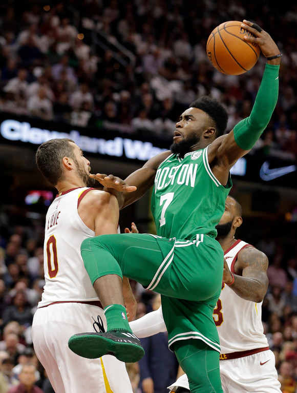 . Boston Celtics\' Jaylen Brown (7) drives against Cleveland Cavaliers\' Kevin Love (0) in the first half of an NBA basketball game, Tuesday, Oct. 17, 2017, in Cleveland. The Cavaliers won 102-99. (AP Photo/Tony Dejak)