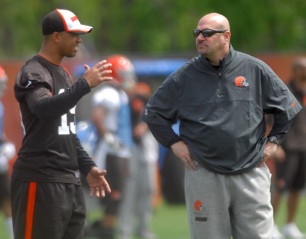 . Michael Allen Blair/Digital First Media Browns\' head coach Mike Pettine talks with wide receiver Mike Austin during Wednesday\'s organized team activities in Berea.