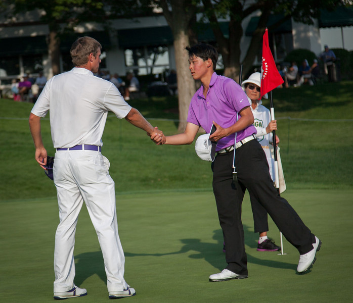 Chris Williams (L) shakes hands with Lorens Chan after winning the low medalist for the second year in a row at the 2012 Western Amateur Championship at Exmoor Country Club in Highland Park IL. on Thursday, August 2, 2012. (WGA Photo/Charles Cherney)