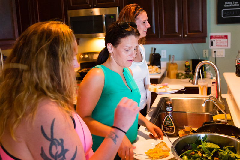 Sober home residents Ashlie Brassbridge (left), Amy Kilgore (center) and Shelby Sparrow (right) fill their plates with food prepared by Sparrow at the All About Recovery younger women's sober home in Loxahatchee, Florida on Wednesday, June 1, 2016. (Joseph Forzano / The Palm Beach Post)