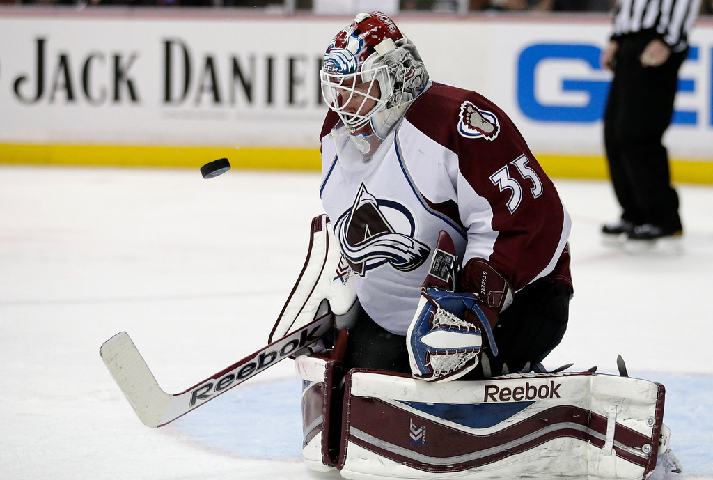 . Colorado Avalanche goalie Jean-Sebastien Giguere deflects the puck during the second period of an NHL hockey game against the Anaheim Ducks on Sunday, April 13, 2014, in Anaheim, Calif. (AP Photo/Jae C. Hong)