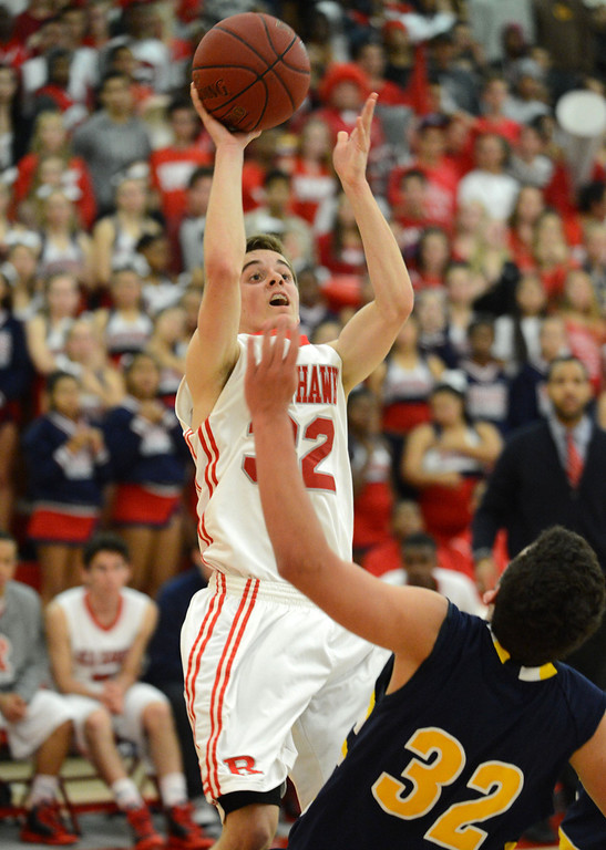 . Redondo Union\'s Ian Fox (32) puts up a shot over Arroyo Grande\'s Brennan Rivera (32) in a CIF Southern Section Division II-A semifinal boys basketball game Tuesday night in Redondo Beach. 20130226 Photo by Steve McCrank / Staff Photographer