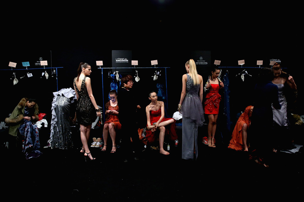 . BEIJING, CHINA - OCTOBER 26:  Models prepare backstage ahead of STELLA LAM Lin Ruoping Dress Collection show during Mercedes-Benz China Fashion Week Spring/Summer 2014 at 751 D-PARK Workshop on October 26, 2013 in Beijing, China.  (Photo by Feng Li/Getty Images)