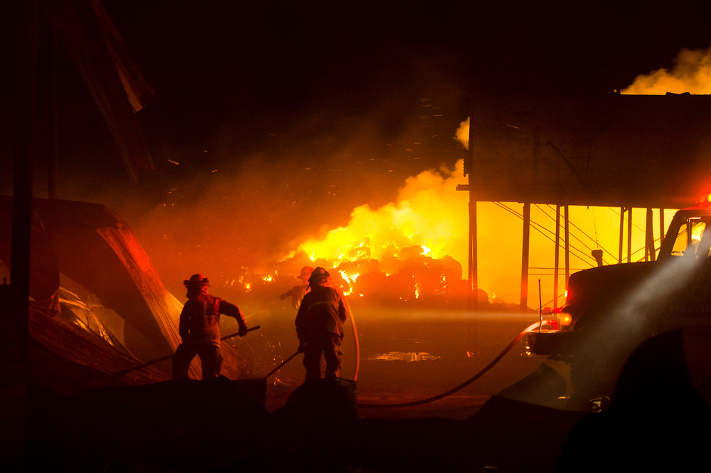 . Firefighters battle a fire burning at a hay barn at Merrill Avenue and Carpenter Avenue in south Ontario on Wednesday, April 30, 2014. (Photo by Watchara Phomicinda/ San Gabriel Valley Tribune)