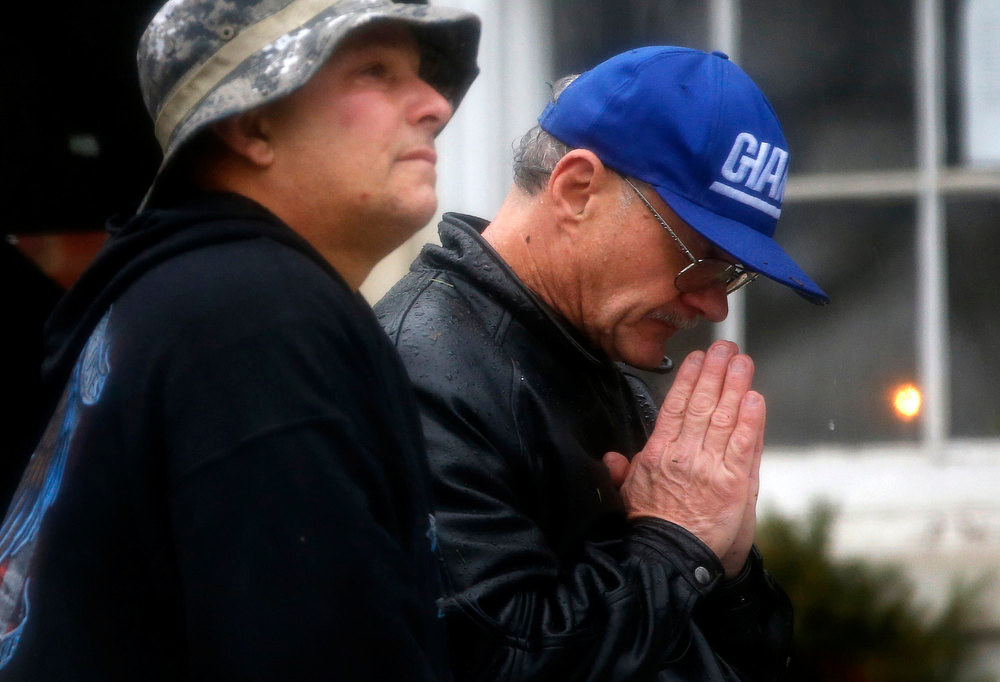Description of . Joe Saleem of Mooresville, North Carolina prays as he stands with others outside the Edmond Town Hall during a moment of silence and ringing of church bells at 9:30am EDT for the victims of the December 14 shooting at the Sandy Hook Elementary school in Newtown, Connecticut, December 21, 2012. REUTERS/Mike Segar