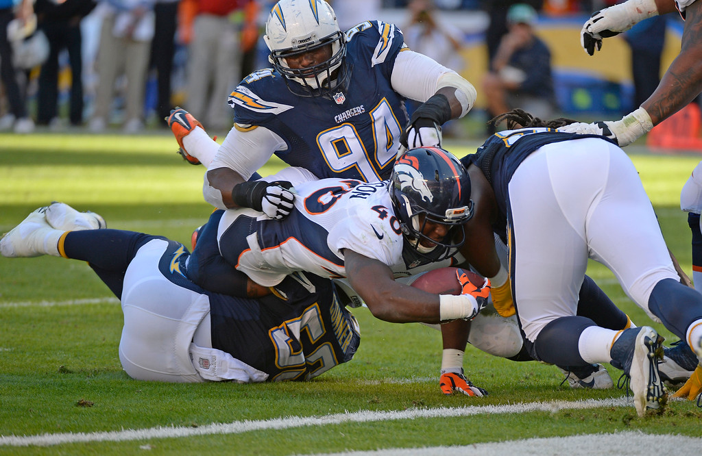 . SAN DIEGO, CA - DECEMBER 14: Denver Broncos running back Juwan Thompson (40) comes up short of the goal line as he gets tackled by San Diego Chargers inside linebacker Kavell Conner (53) during the second quarter December 14, 2014 at Qualcomm Stadium (Photo By John Leyba/The Denver Post)
