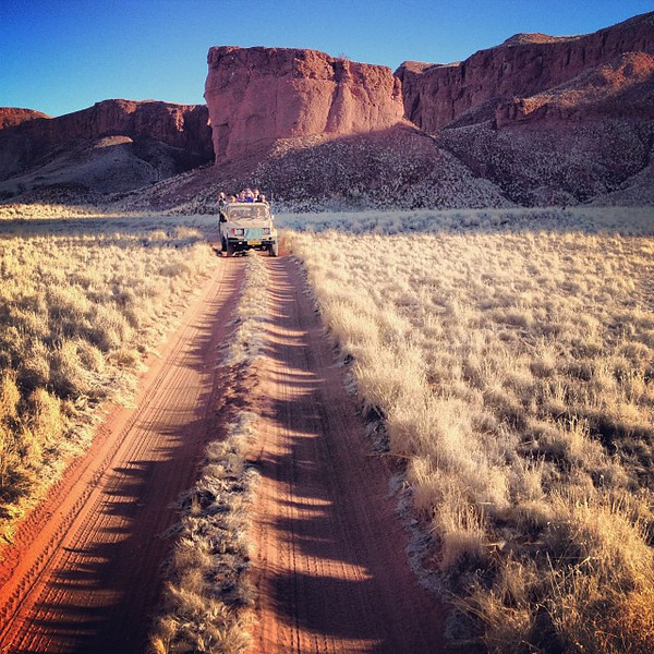 Late afternoon drive through petrified dunes. On the road, Namibia style. Namib-Naukluft Park.