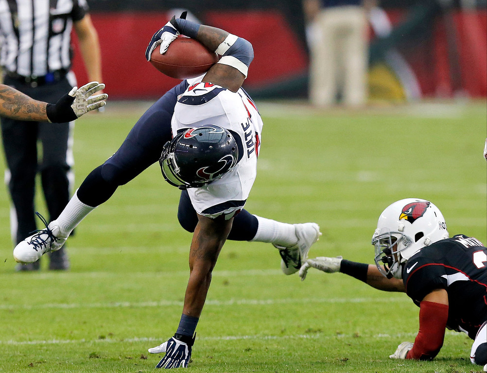 . Houston Texans running back Ben Tate, left, is tackled by Arizona Cardinals free safety Tyrann Mathieu, right, during the first half of an NFL football game Sunday, Nov. 10, 2013, in Glendale, Ariz. (AP Photo/Ross D. Franklin)