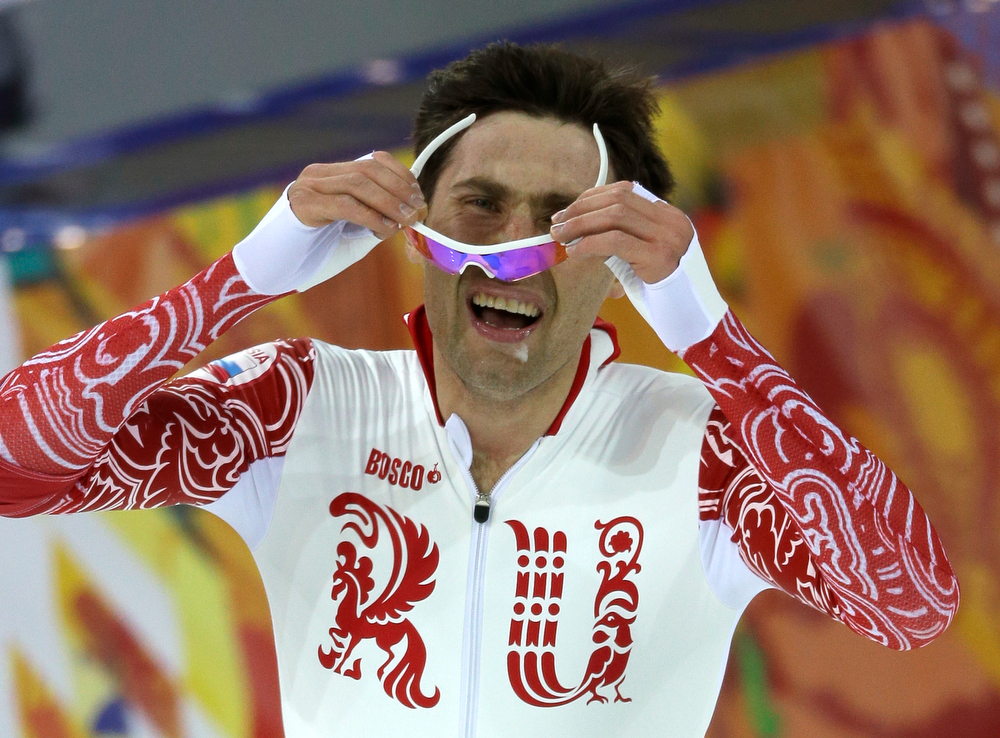 . Russia\'s Aleksandr Rumyantsev removes his glasses after competing in the Men\'s 5,000-meter speed skating event at the 2014 Winter Olympics, Saturday, Feb. 8, 2014, in Sochi, Russia. (AP Photo/David J. Phillip )