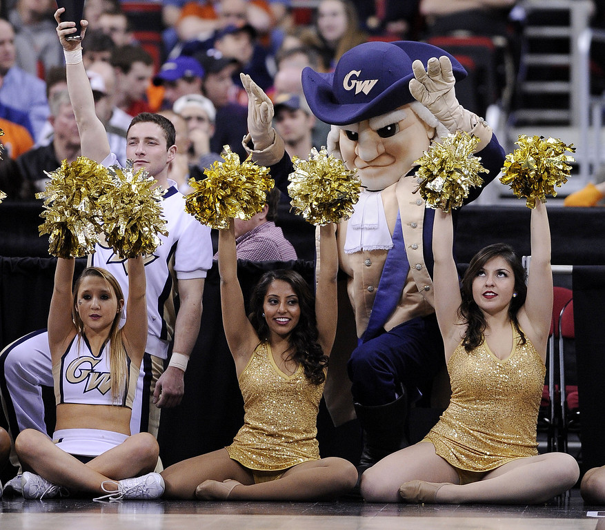 . George Washington Colonials cheerleaders perform in the first half against the Memphis Tigers during the Second Round of the 2014 NCAA Basketball Tournament at PNC Arena on March 21, 2014 in Raleigh, North Carolina.  (Photo by Grant Halverson/Getty Images)