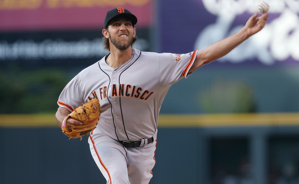 . San Francisco Giants starting pitcher Madison Bumgarner works against the Colorado Rockies in the first inning of a baseball game in Denver on Tuesday, May 20, 2014. (AP Photo/David Zalubowski)