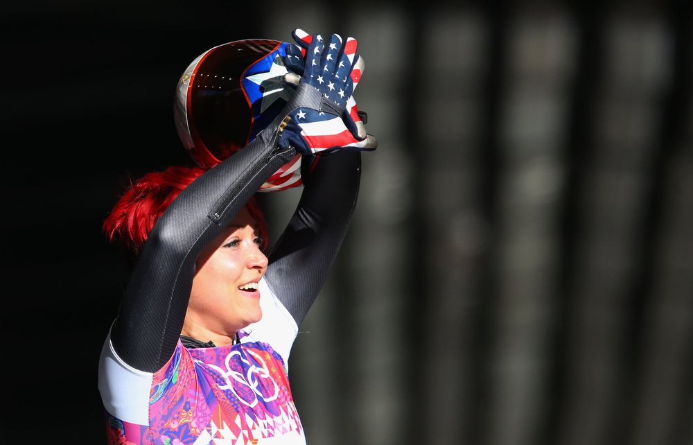 . Katie Uhlaender of the United States reacts during the Women\'s Skeleton heats on Day 6 of the Sochi 2014 Winter Olympics at Sliding Center Sanki on February 13, 2014 in Sochi, Russia.  (Photo by Alex Livesey/Getty Images)