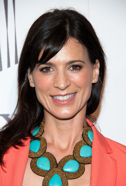 """. Perrey Reeves arrives at \""""An Evening\"""" Benefiting The L.A. Gay & Lesbian Center at the Beverly Wilshire Four Seasons Hotel on March 21, 2013 in Beverly Hills, California. (Photo by Valerie Macon/Getty Images)"""