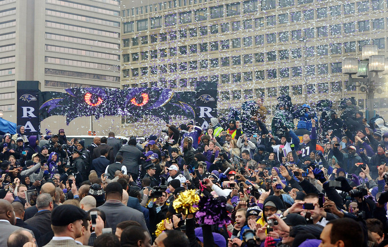 . Confetti falls during a send-off rally for the Baltimore Ravens on Monday, Jan. 28, 2013 in Baltimore. The NFL football team is leaving for New Orleans to face the San Francisco 49ers in the Super Bowl. (AP Photo/Steve Ruark)