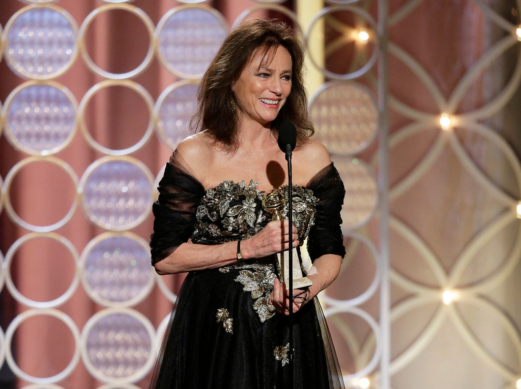 """. This image released by NBC shows Jacqueline Bissett accepting the award for best supporting actress in a series, mini-series or TV movie for her role in, \""""Dancing on the Edge\"""" during the 71st annual Golden Globe Awards at the Beverly Hilton Hotel on Sunday, Jan. 12, 2014, in Beverly Hills, Calif. (AP Photo/NBC, Paul Drinkwater)"""