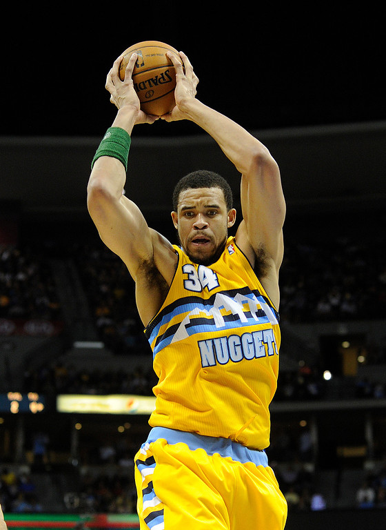 . DENVER, CO. - APRIL 6: JaVale McGee (34) of the Denver Nuggets came down with the ball in the first half. The Denver Nuggets hosted the Houston Rockets at the Pepsi Center Saturday night, April 6, 2013. Photo By Karl Gehring/The Denver Post)