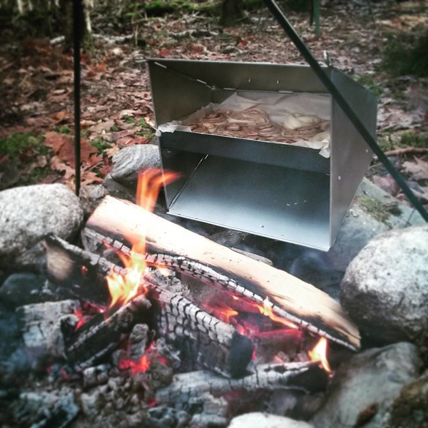 #Campfire cooking in #Maine with a Maine developed campfire reflector oven. From scratch cinnamon buns!! #food #foodies #maineguide