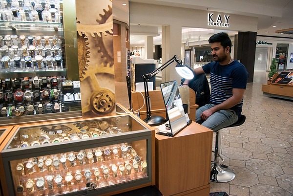 03/18/20 Wesley Bunnell | Staff What few shoppers visited the Westfarms Mall on Wednesday March 18, 2020 were greeted by fewer open stores. Krishna Baskarabatla sits at his watch stand waiting for customers.