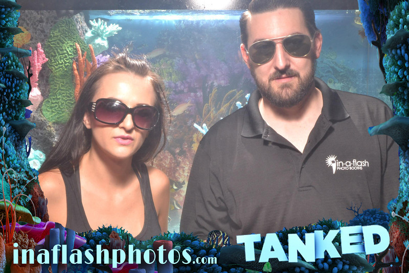 Ashley Ellwood and Frankie DeFrancesco in between the two water-filled tanks