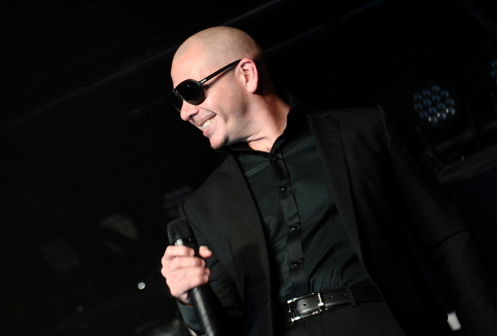 . Rapper Pitbull performs at Club SI Swimsuit at 1 OAK Nightclub at The Mirage Hotel & Casino on February 14, 2013 in Las Vegas, Nevada.  (Photo by Michael Loccisano/Getty Images for Sports Illustrated)