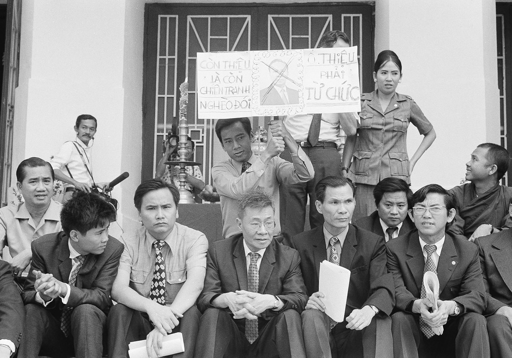 . Opposition deputies stage a 24-hour sit-in hunger strike on the steps of the national assembly to protest what they term ?The corrupt, inefficient and oppressive administration? of President Nguyen Van Thieu in Saigon, Feb. 10, 1975. One deputy hoists a placard with defaced photo of Thieu which says: ?If Thieu still remains in power, there will still exist war, poverty and starvation. Mr. Thieu must resign.? (AP Photo/Ut)