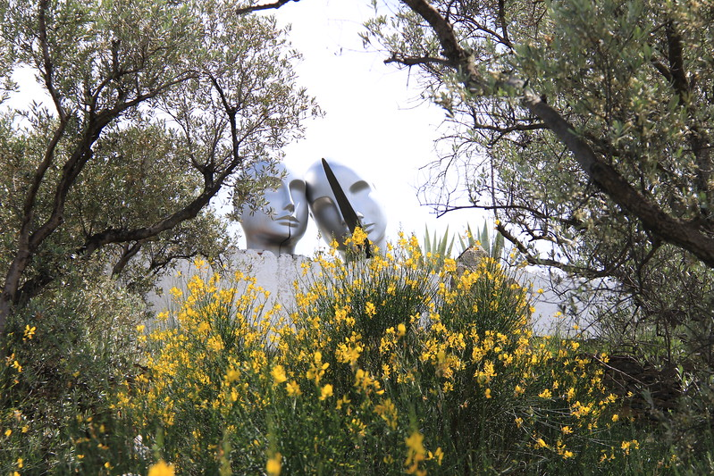 Yellow flowers bloom in the garden of the Dali house on a tour from Girona.