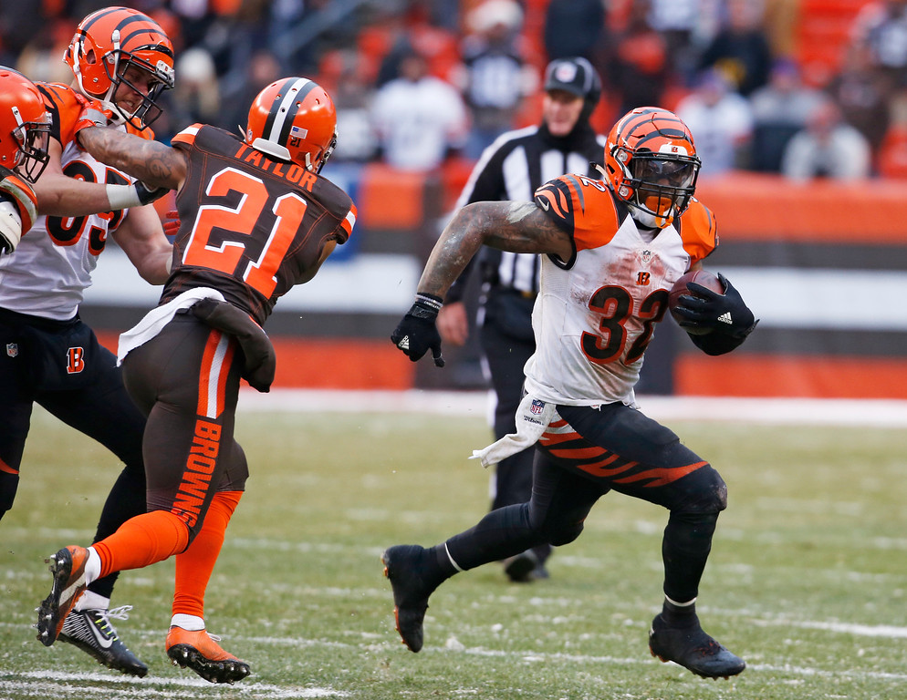 . Cincinnati Bengals running back Jeremy Hill (32) runs the ball in the second half of an NFL football game against the Cleveland Browns, Sunday, Dec. 11, 2016, in Cleveland. (AP Photo/Ron Schwane)
