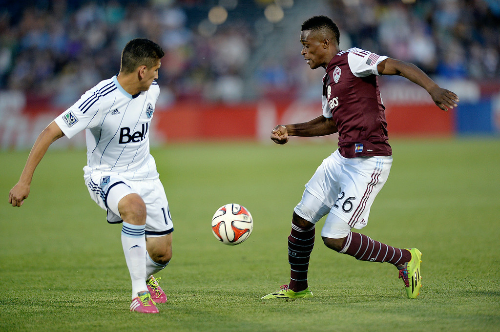 . COMMERCE CITY, CO - JUNE 28: Colorado forward Deshorn Brown (26) worked against Vancouver defender Johnny Leveron (16) in the second half. The Colorado Rapids defeated the Vancouver Whitecaps 2-0 at Dick\'s Sporting Goods Park Saturday night, June 28, 2014.  Photo by Karl Gehring/The Denver Post