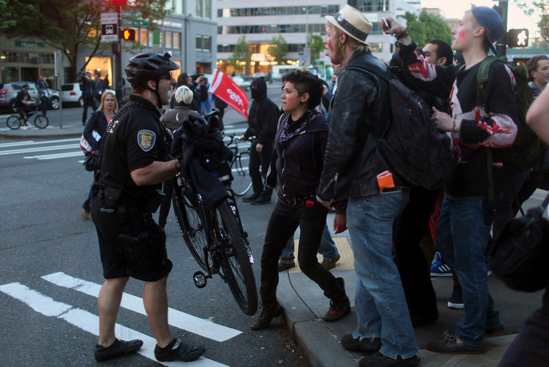 . Police and demonstrators clash during May Day demonstrations in Seattle, Washington May 1, 2013. Protesters clashed with police in Seattle on Wednesday as a May Day rally that began peacefully turned violent after dark, with demonstrators hurling objects at officers who responded by firing flash-bang grenades and pepper spray.  REUTERS/Matt Mills McKnight