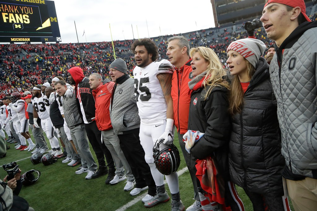 . Ohio State head coach Urban Meyer stands with his wife Shelley after the NCAA college football game against Michigan, Saturday, Nov. 25, 2017, in Ann Arbor, Mich. (AP Photo/Carlos Osorio)