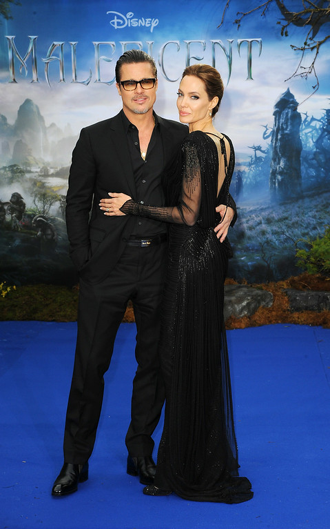 ". Brad Pitt and Angelina Jolie attend a private reception as costumes and props from Disney\'s ""Maleficent\"" are exhibited in support of Great Ormond Street Hospital at Kensington Palace on May 8, 2014 in London, England.  (Photo by Eamonn M. McCormack/Getty Images)"