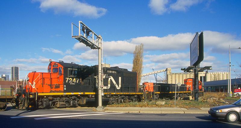 GP9RM 7228 + 7247 with slug 221 on a transfer into the Port of Montreal.