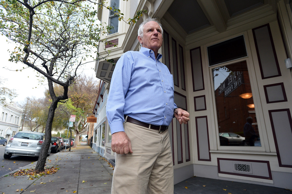 . Richmond city council member Tom Butt talks about the history of the area as he strolls in the Point Richmond area of Richmond, Calif. on Thursday, Jan. 24, 2013. (Kristopher Skinner/Staff)